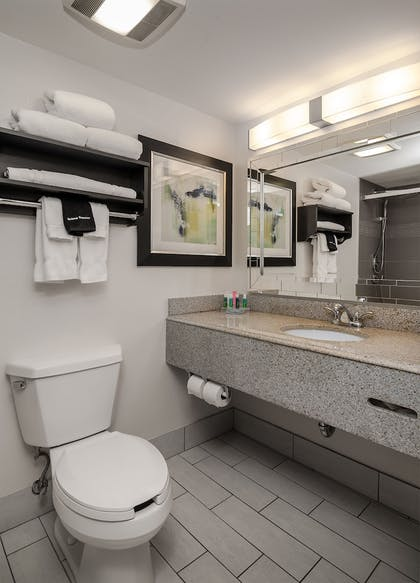 Bathroom | Maplewood Suites Extended Stay- Syracuse/Airport