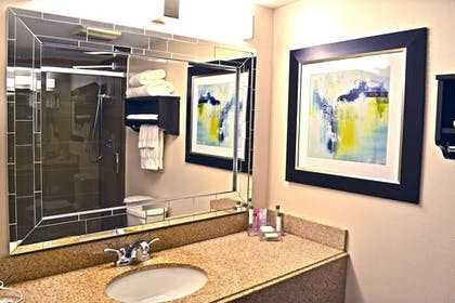 Bathroom Sink | Maplewood Suites Extended Stay- Syracuse/Airport