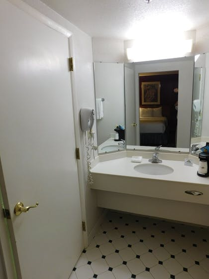 Bathroom Sink | Days Inn & Suites by Wyndham Arlington Heights