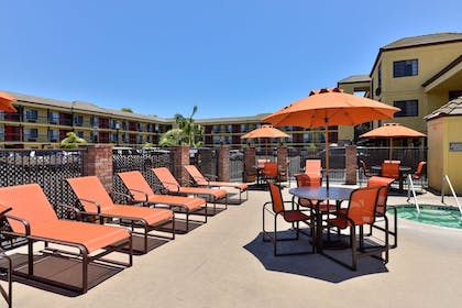 Outdoor Pool | Best Western Plus Raffles Inn & Suites