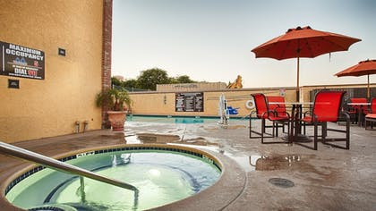 Outdoor Spa Tub | Best Western Plus Raffles Inn & Suites