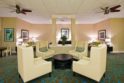 Lobby Sitting Area | Holiday Inn & Suites Across From Universal Orlando