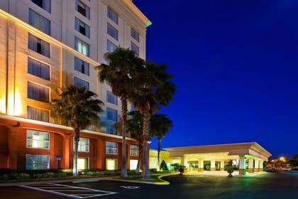Hotel Front - Evening/Night | Holiday Inn & Suites Across From Universal Orlando