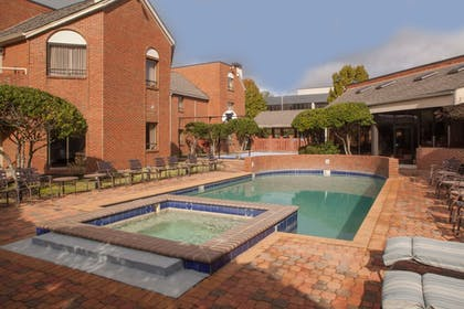 Outdoor Pool | Cloverleaf Suites Baton Rouge