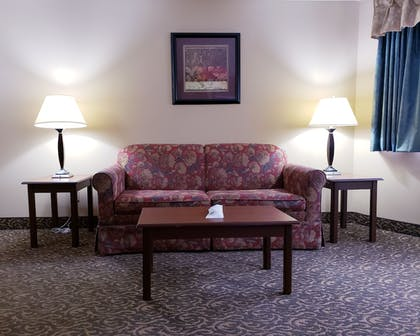 Living Room | SureStay Plus Hotel by Best Western Black River Falls