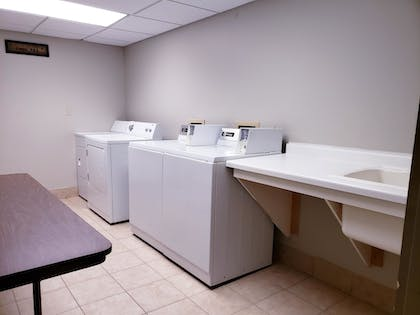 Laundry Room | SureStay Plus Hotel by Best Western Black River Falls