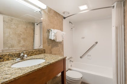 Bathroom | Ramada Hotel & Conference Center by Wyndham State College