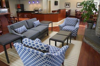 Lobby Sitting Area | New Haven Village Suites
