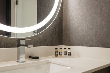 Bathroom | Revel Hotel Des Moines Urbandale, Tapestry Collection by Hilton