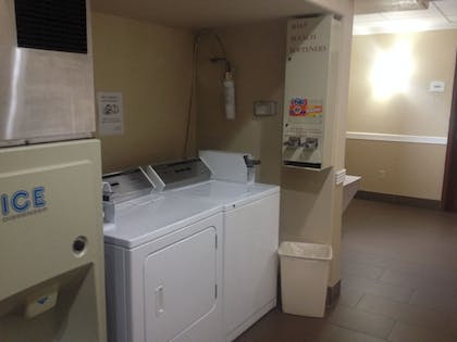 Laundry Room | Quality Suites Cy - Fair at Jones Road