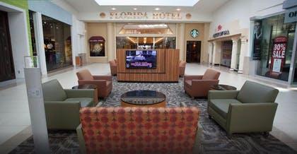 Lobby Sitting Area | Florida Hotel & Conference Center in the Florida Mall, BW Premier Coll