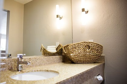 Bathroom Sink | Quality Inn & Suites By the Parks