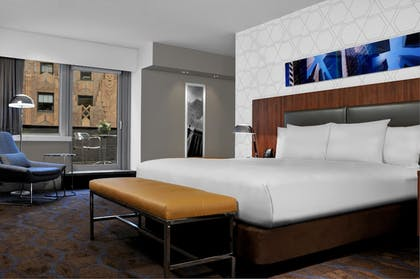 | 1 King Suite with Balcony Non-smoking + 1 King Bed - High Floor - Non-smoking | DoubleTree by Hilton Metropolitan - New York City
