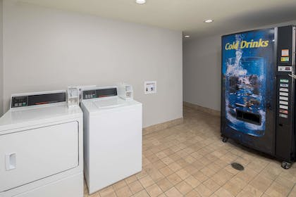 Laundry Room | Days Inn & Suites by Wyndham Athens Alabama