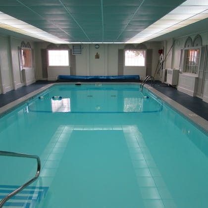 Indoor Pool | Magnuson Grand Pioneer Inn and Suites