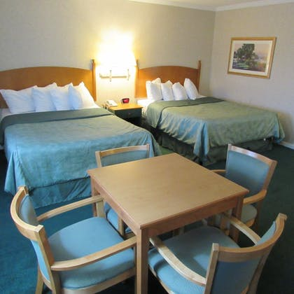 Guestroom | Magnuson Grand Pioneer Inn and Suites