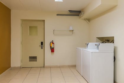 Laundry Room | Quality Inn & Suites Conference Center