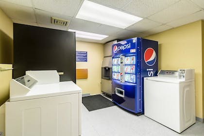 Laundry Room | Quality Inn & Suites Mayo Clinic Area