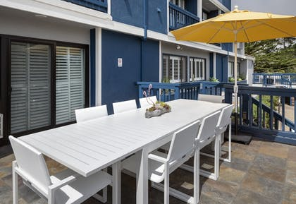 Terrace/Patio | Mariposa Inn & Suites