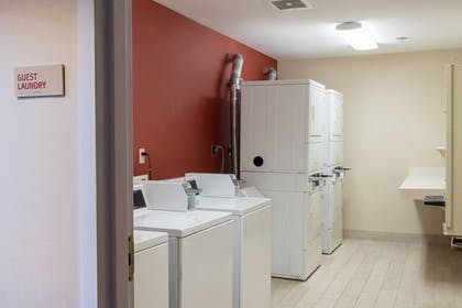Laundry Room | TownePlace Suites by Marriott Lafayette