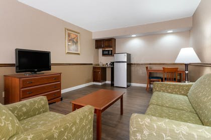 Living Area | Quality Inn & Suites Conference Center
