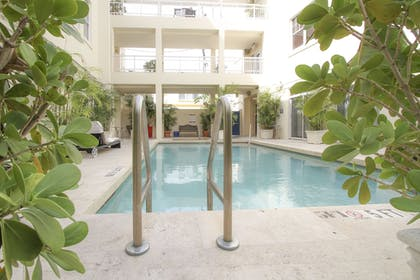 Outdoor Pool | The Mercury All-Suites Hotel