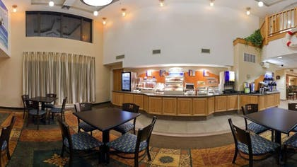 Breakfast Area | Holiday Inn Express Hotel & Suites Carneys Point
