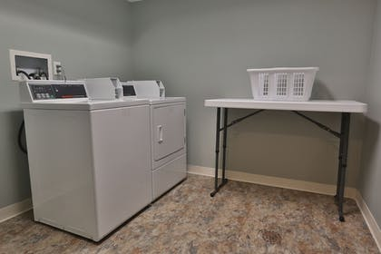 Laundry Room | Ivy Court Inn & Suites