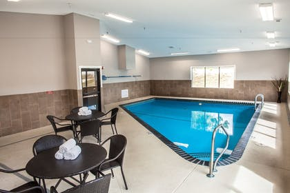 Indoor/Outdoor Pool | Heartland Inn