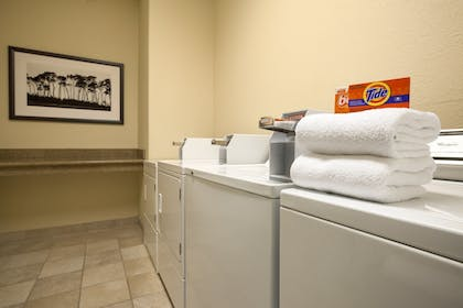 Laundry Room | Quality Inn & Suites