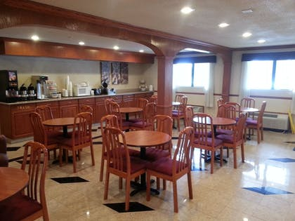 Breakfast Area | Days Inn & Suites by Wyndham Monroe