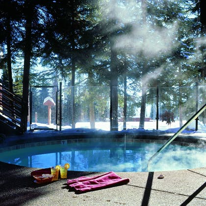 Outdoor Spa Tub | Kandahar Lodge at Whitefish Mountain Resort