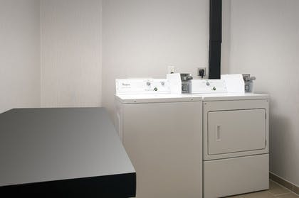 Laundry Room | Holiday Inn Express & Suites San Antonio-Dtwn Market Area
