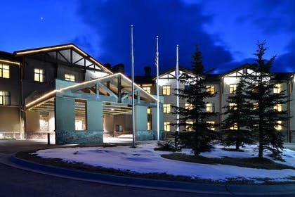 Hotel Front - Evening/Night | The Lodge at Big Sky