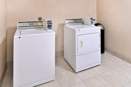 Laundry Room | Hampton Inn Houston Deer Park Ship Area