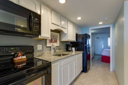 In-Room Kitchen | Camelot By The Sea by Oceana Resorts