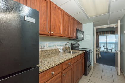 In-Room Kitchenette | Camelot By The Sea by Oceana Resorts