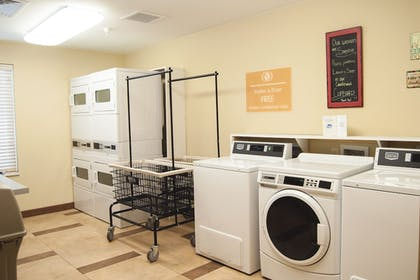 Laundry Room | Candlewood Suites Fort Collins