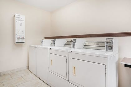 Laundry Room | AmericInn by Wyndham Johnston Des Moines