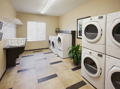 Laundry Room | Candlewood Suites College Station At University