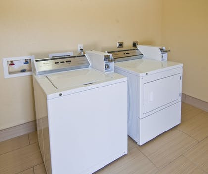 Laundry Room | Executive Inn and Suites Tyler