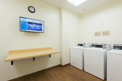 Laundry Room | TownePlace Suites by Marriott Champaign Urbana/Campustown