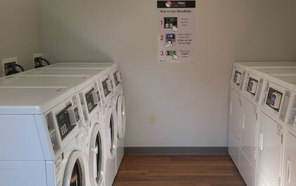Laundry Room | Affordable Suites of America Portage