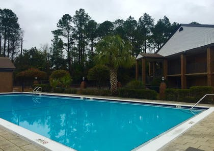 Outdoor Pool | At Home Inn & Suites