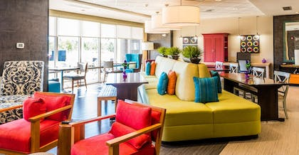 Lobby Sitting Area | Home2 Suites by Hilton Gulfport I-10