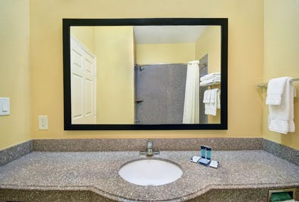 Bathroom Sink | Galveston Inn & Suites Hotel