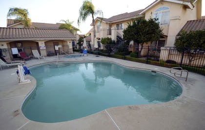 Pool   Garden Inn and Suites