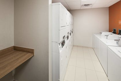 Laundry Room | TownePlace Suites by Marriott Orlando at SeaWorld