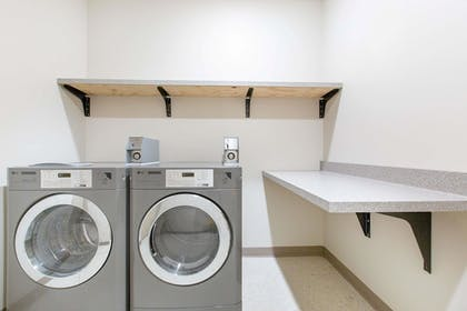 Laundry Room | AmericInn by Wyndham Humboldt