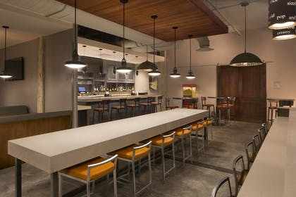 Restaurant | TownePlace Suites by Marriott Foley at OWA